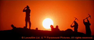 Indiana Jones and the Raiders of the Lost Ark Screenshot - Indiana Jones silhouetted against the sun at the Well of Souls