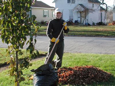Photo of Chad Kerychuk raking leaves.
