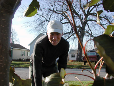 Another photo of Chad Kerychuk raking leaves.