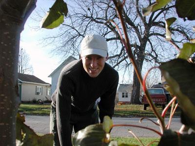 Another photo of Chad Kerychuk raking leaves.